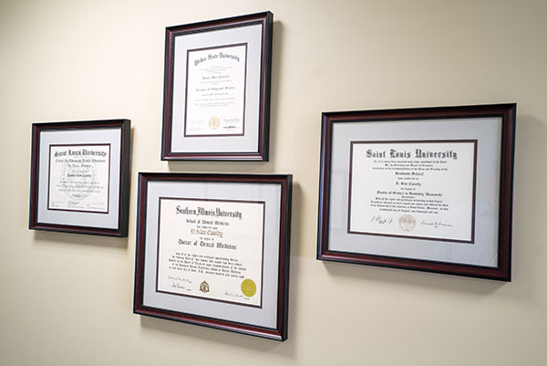 Framed doctor certifications at periodontist office in South Ogden, UT.